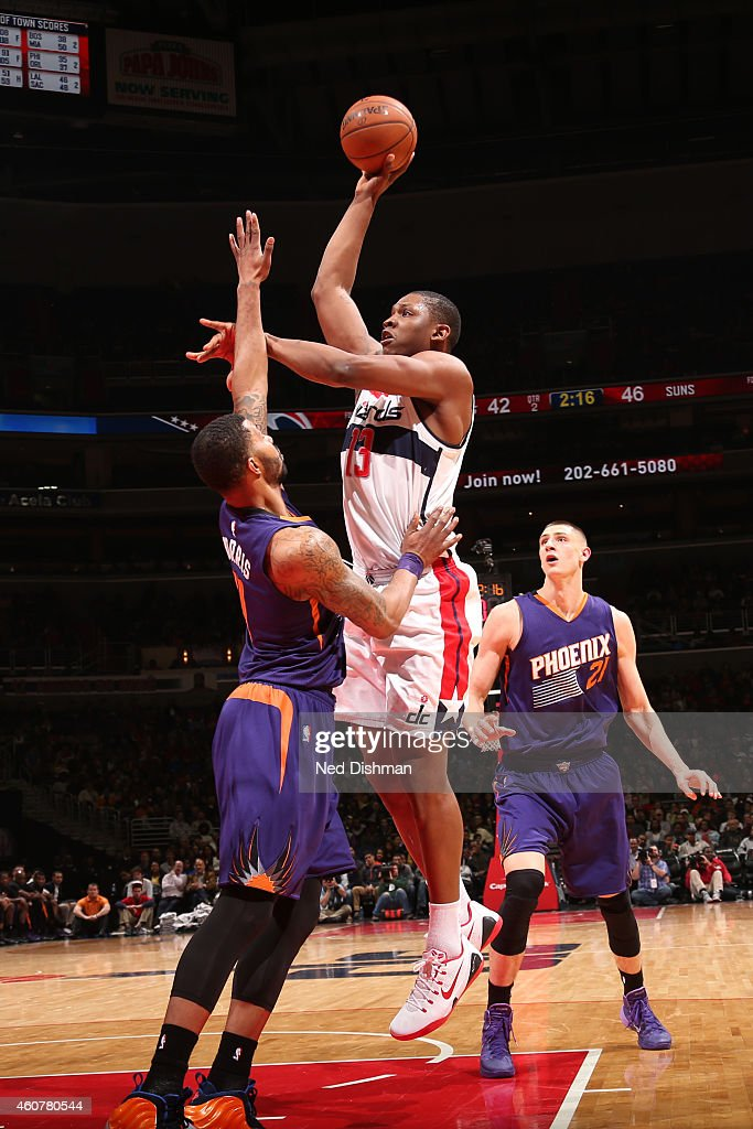 Kevin Seraphin #13 of the Washington Wizards shoots the ball against the Phoenix Suns on December 21, 2014 at Verizon Center in Washington, District of Columbia.