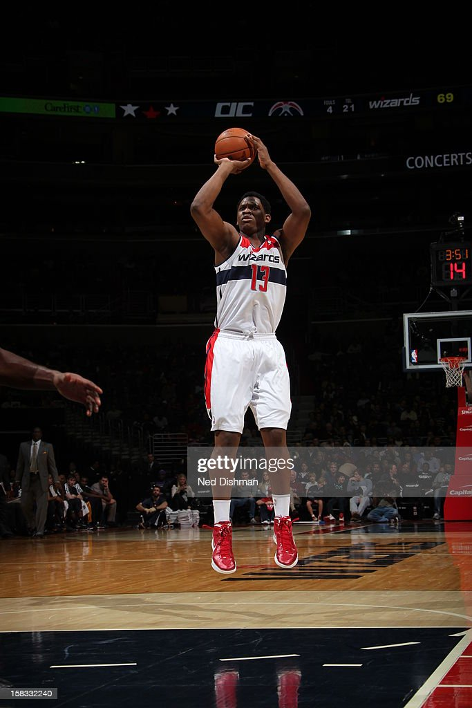 <a gi-track='captionPersonalityLinkClicked' href=/galleries/search?phrase=Kevin+Seraphin&family=editorial&specificpeople=6474998 ng-click='$event.stopPropagation()'>Kevin Seraphin</a> #13 of the Washington Wizards takes a shot against the Utah Jazz at the Verizon Center on November 17, 2012 in Washington, DC.