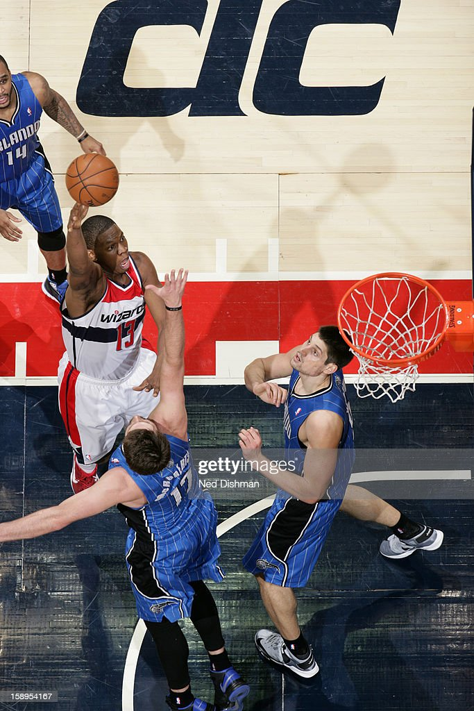 <a gi-track='captionPersonalityLinkClicked' href=/galleries/search?phrase=Kevin+Seraphin&family=editorial&specificpeople=6474998 ng-click='$event.stopPropagation()'>Kevin Seraphin</a> #13 of the Washington Wizards takes a shot against the Orlando Magic at the Verizon Center on December 28, 2012 in Washington, DC.