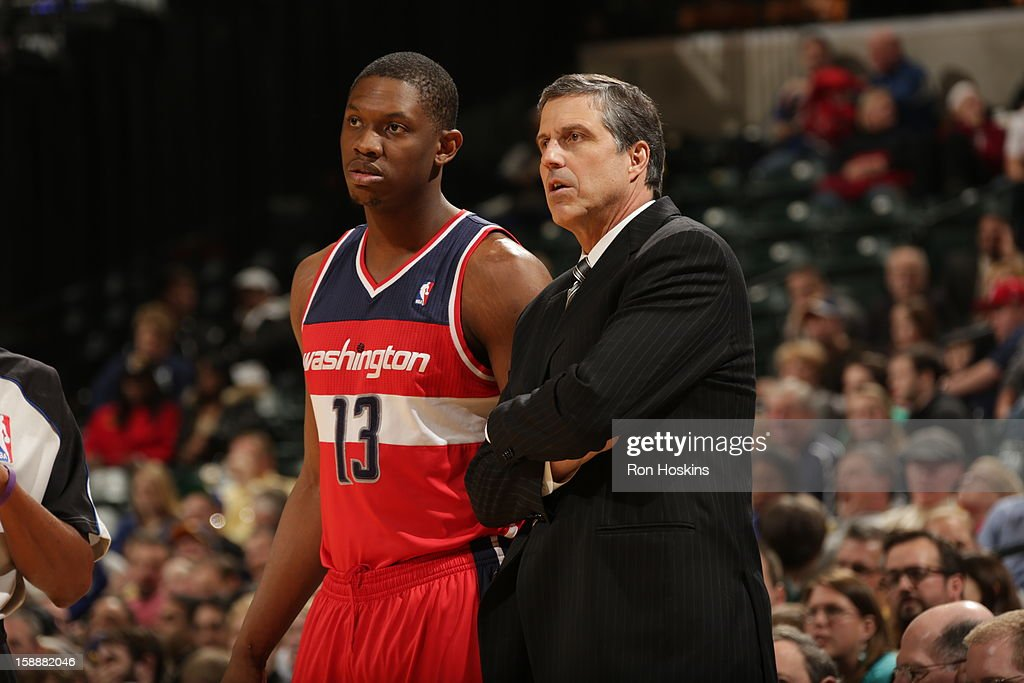 Kevin Seraphin #13 of the Washington Wizards talks with Head Coach Randy Wittman during the game against the Indiana Pacers on January 2, 2013 at Bankers Life Fieldhouse in Indianapolis, Indiana.