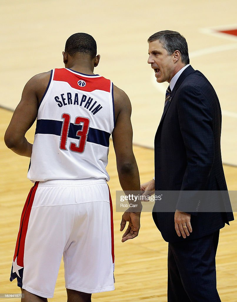 Kevin Seraphin #13 of the Washington Wizards talks with head coach Randy Wittman during the first half of the Wizards 96-88 loss to the New York Knicks at Verizon Center on March 1, 2013 in Washington, DC.