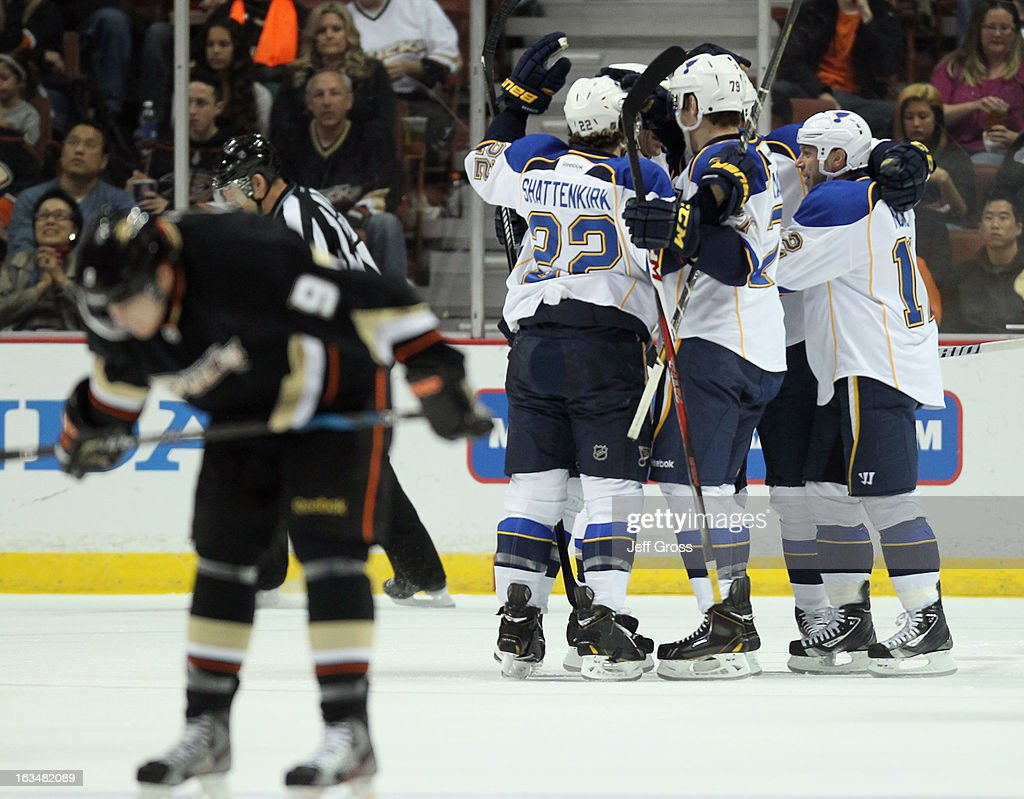 Kevin Shattenkirk Adam Cracknell and Scott Nichol of the St Louis Blues celebrate a goal by Ryan Reaves in the first period goal against the Anaheim...