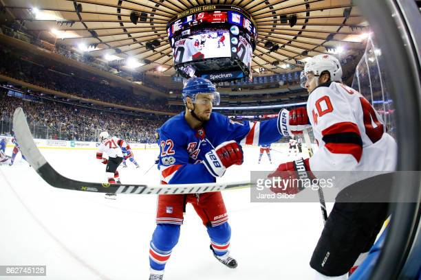 Kevin Shattenkirk of the New York Rangers defends against Blake Coleman of the New Jersey Devils at Madison Square Garden on October 14 2017 in New...