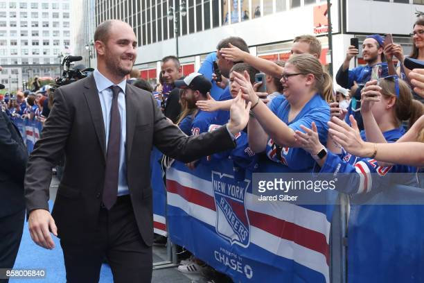 Kevin Shattenkirk of the New York Rangers greets fans as he walks the Blue Carpet prior to the home opener against the Colorado Avalanche at Madison...