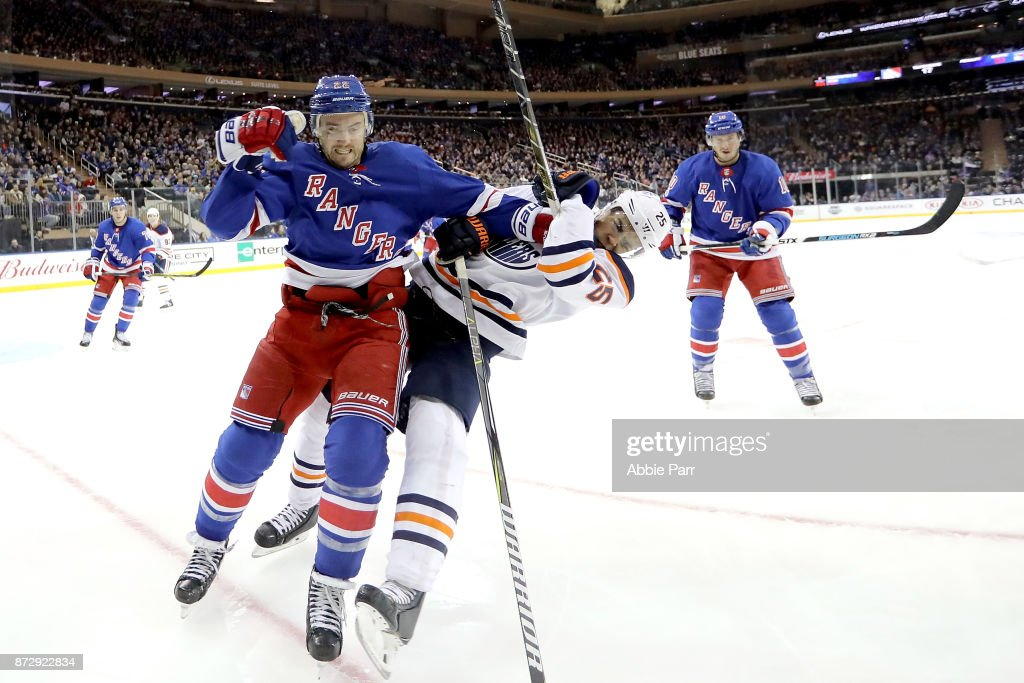 Kevin Shattenkirk #22 of the New York Rangers shoves Darnell Nurse #25 of the Edmonton Oilers in the third period during their game at Madison Square Garden on November 11, 2017 in New York City.