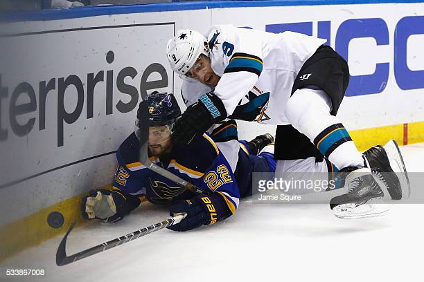 Kevin Shattenkirk of the St Louis Blues and Dainius Zubrus of the San Jose Sharks battle for the puck during the second period in Game Five of the...