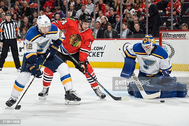 Kevin Shattenkirk of the St Louis Blues and Richard Panik of the Chicago Blackhawks watch the puck fly past goalie Brian Elliott in the first period...