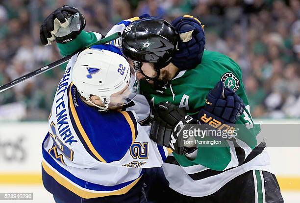 Kevin Shattenkirk of the St Louis Blues and Vernon Fiddler of the Dallas Stars fight in the third period in Game Five of the Western Conference...