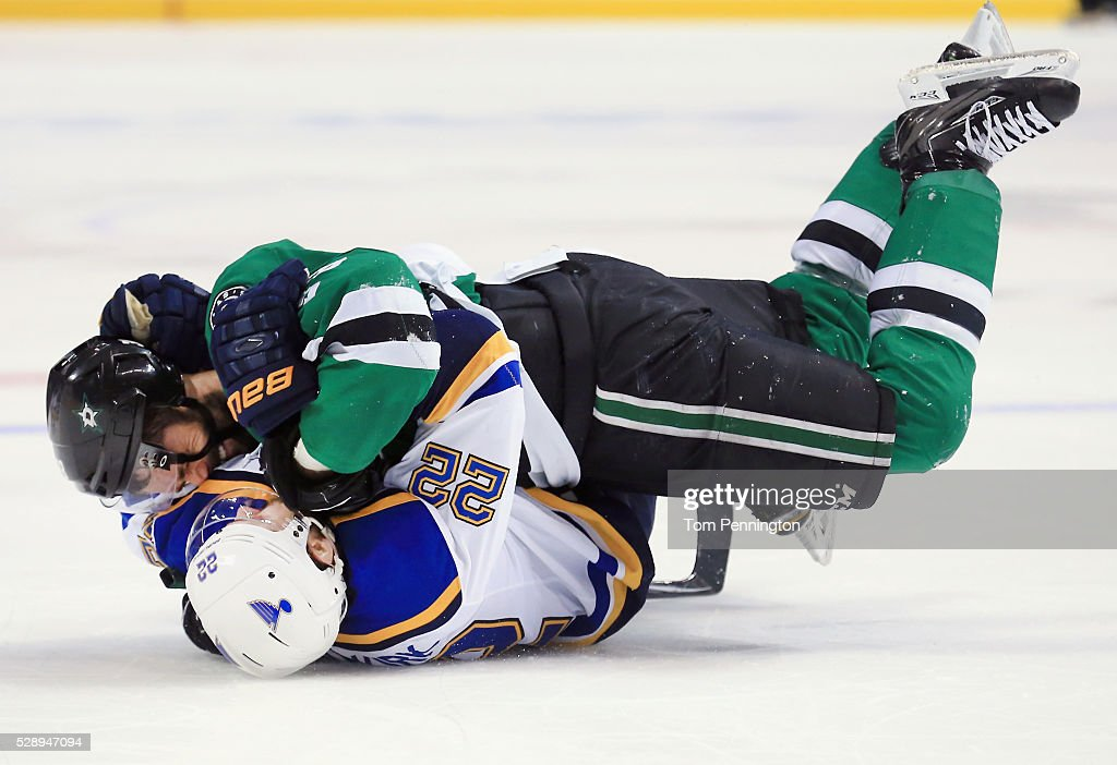 Kevin Shattenkirk #22 of the St. Louis Blues and Vernon Fiddler #38 of the Dallas Stars fight in the third period in Game Five of the Western Conference Second Round during the 2016 NHL Stanley Cup Playoffs at American Airlines Center on May 7, 2016 in Dallas, Texas.