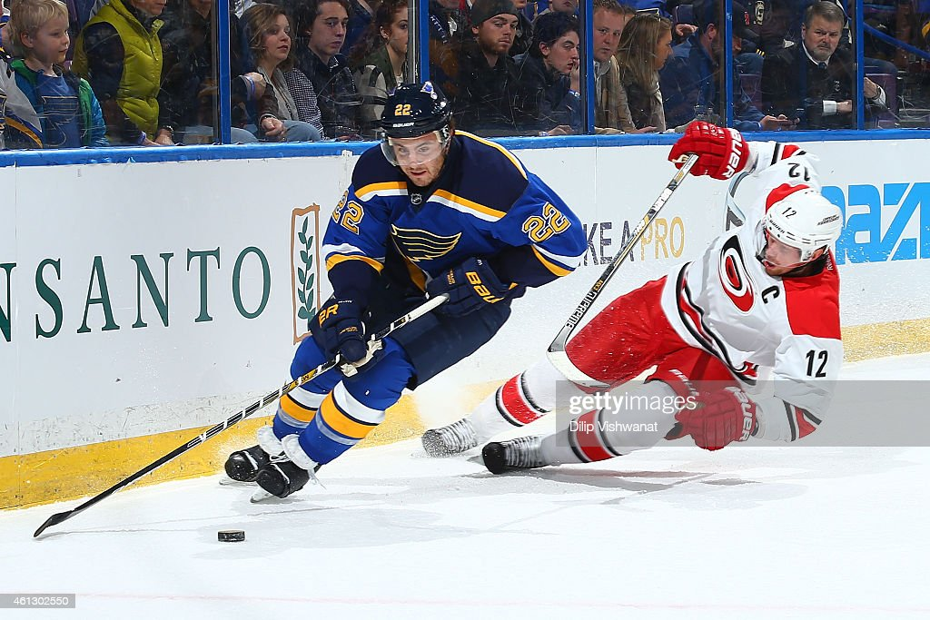 Kevin Shattenkirk of the St Louis Blues beats Eric Staal of the Carolina Hurricanes to a loose puck at the Scottrade Center on January 10 2015 in St...