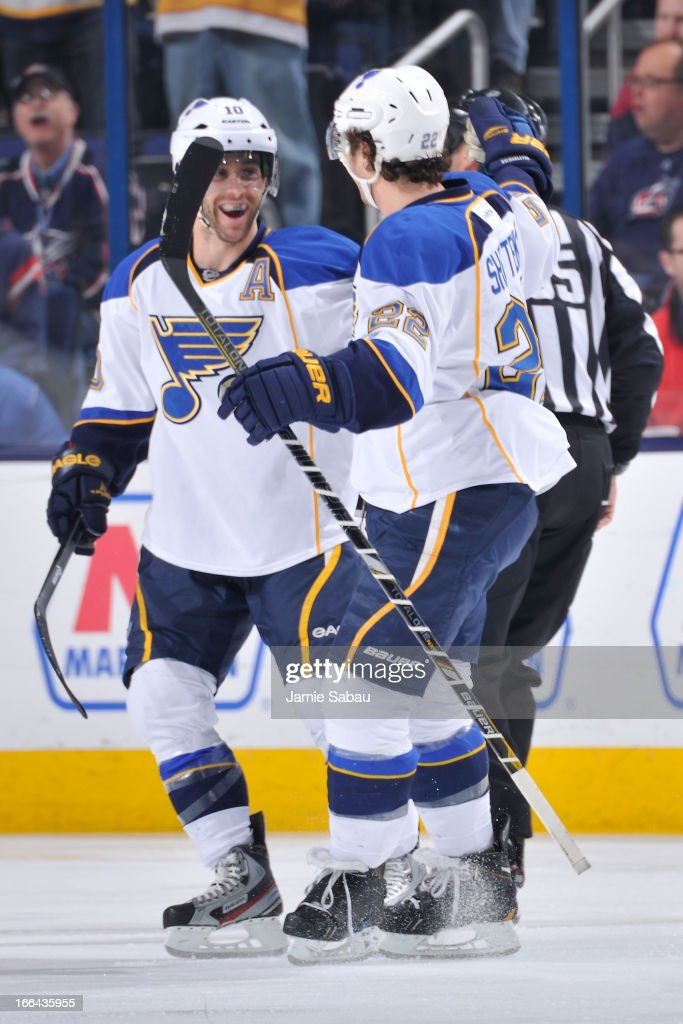 Kevin Shattenkirk #22 of the St. Louis Blues celebrates with teammate Andy McDonald #10 after scoring a goal against the Columbus Blue Jackets during the first period on April 12, 2013 at Nationwide Arena in Columbus, Ohio.