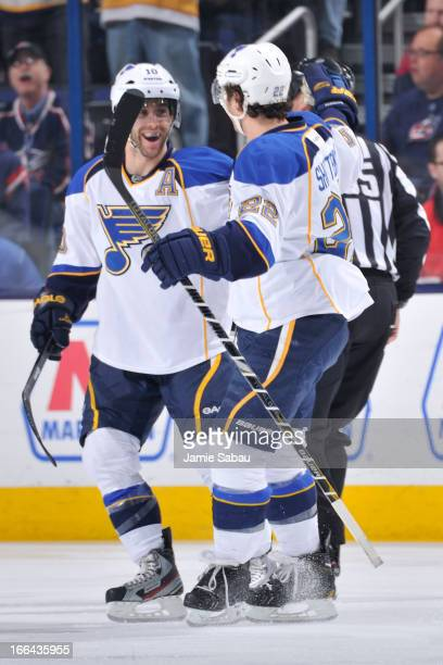 Kevin Shattenkirk of the St Louis Blues celebrates with teammate Andy McDonald after scoring a goal against the Columbus Blue Jackets during the...