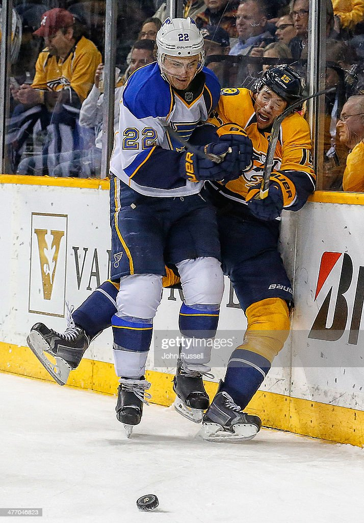 <a gi-track='captionPersonalityLinkClicked' href=/galleries/search?phrase=Kevin+Shattenkirk&family=editorial&specificpeople=4324986 ng-click='$event.stopPropagation()'>Kevin Shattenkirk</a> #22 of the St. Louis Blues checks Craig Smith #15 of the Nashville Predators at Bridgestone Arena on March 6, 2014 in Nashville, Tennessee.