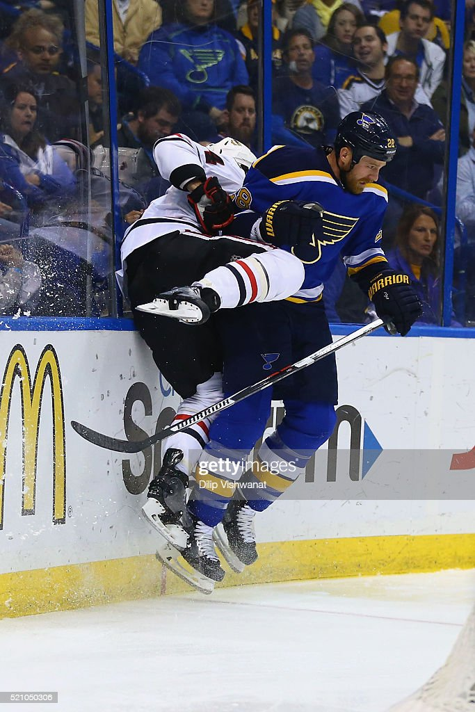 Kevin Shattenkirk of the St Louis Blues checks Niklas Hjalmarsson of the Chicago Blackhawks in Game One of the Western Conference Quarterfinals...