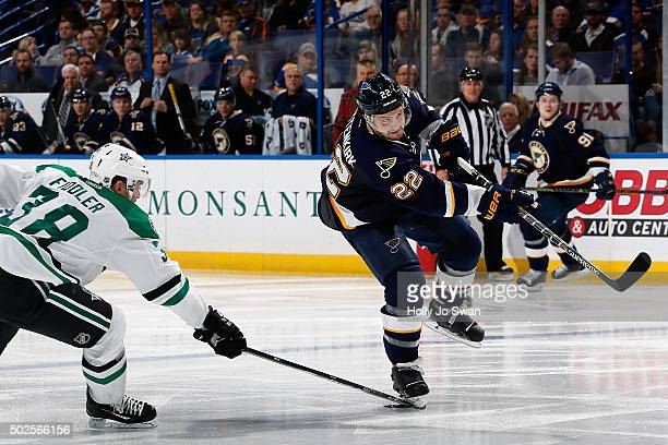 Kevin Shattenkirk of the St Louis Blues shoots as Vernon Fiddler of the Dallas Stars defends on December 26 2015 at Scottrade Center in St Louis...