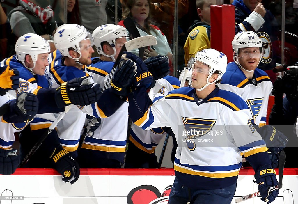 Kevin Shattenkirk of the St Louis Blues skates back to the bench to celebrate his shootout goal after an NHL game against the Carolina Hurricanes at...