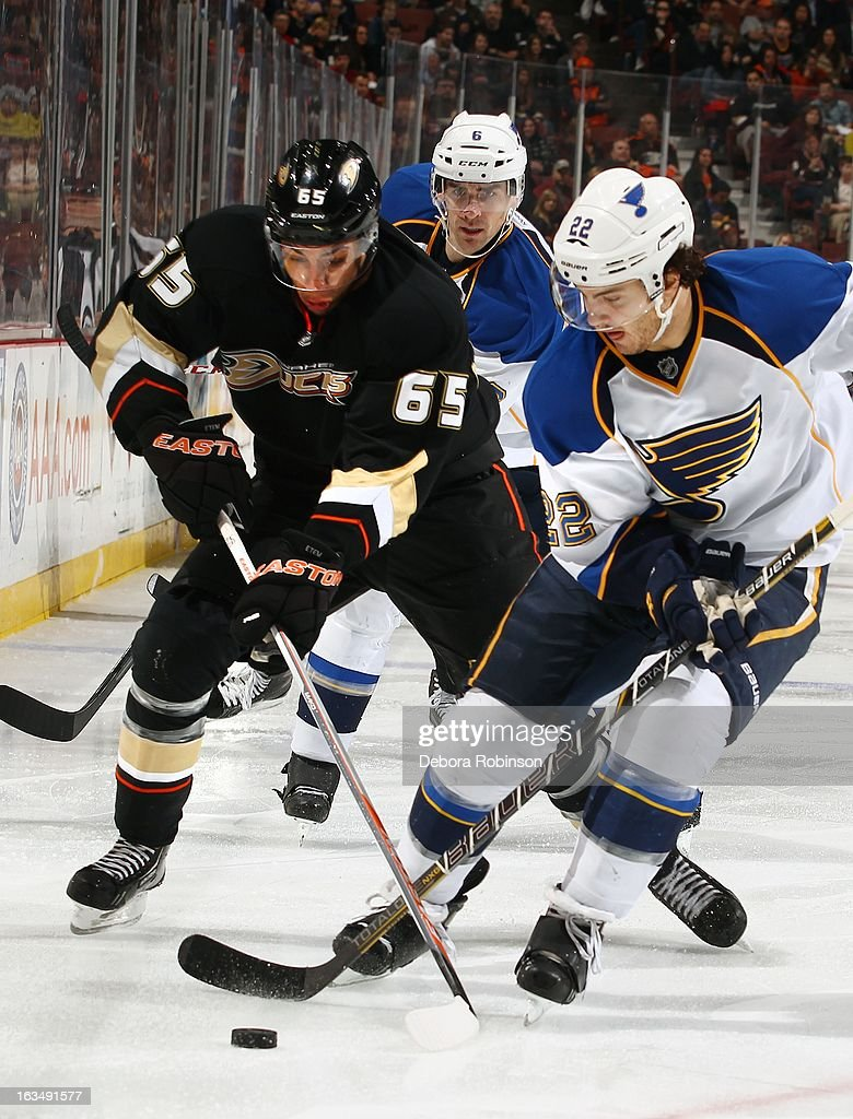 Kevin Shattenkirk #22 of the St. Louis Blues steals the puck from Emerson Etem #65 of the Anaheim Ducks while teammate Wade Redden #6 watches on March 10, 2013 at Honda Center in Anaheim, California.