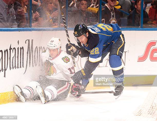 Kevin Shattenkirk of the St Louis Blues takes down Sheldon Brookbank of the Chicago Blackhawks in Game Five of the First Round of the 2014 Stanley...