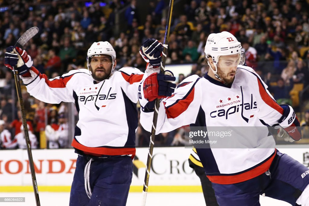 Kevin Shattenkirk #22 of the Washington Capitals celebrates with Alex Ovechkin #8 after scoring against the Boston Bruins during the second period at TD Garden on April 8, 2017 in Boston, Massachusetts.