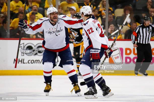 Kevin Shattenkirk of the Washington Capitals reacts to his overtime goal to beat the Pittsburgh Penguins 32 with Alex Ovechkin in Game Three of the...
