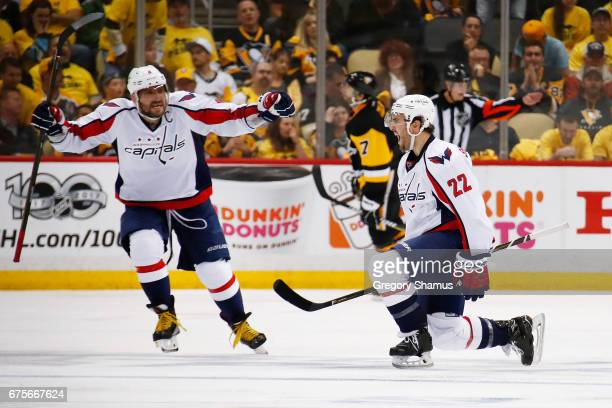 Kevin Shattenkirk of the Washington Capitals reacts to his overtime goal to defeat the Pittsburgh Penguins 32 with Alex Ovechkin in Game Three of the...