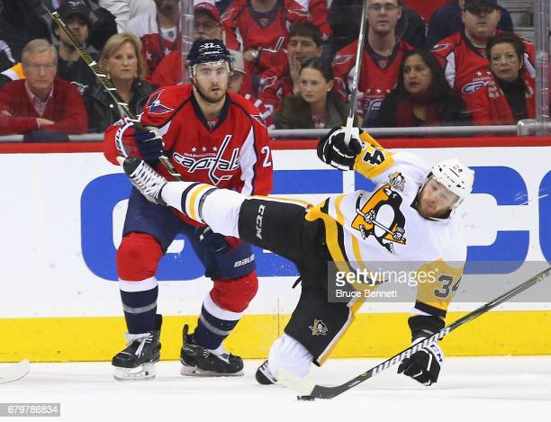 Kevin Shattenkirk of the Washington Capitals trips up Tom Kuhnhackl of the Pittsburgh Penguins during the first period in Game Five of the Eastern...