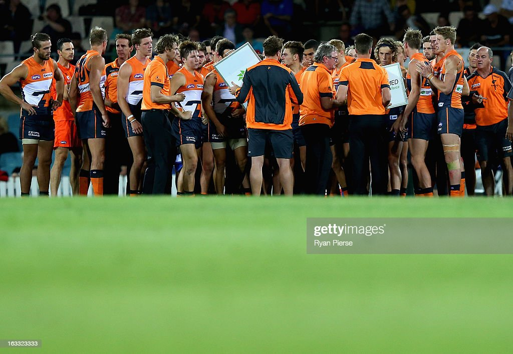 <a gi-track='captionPersonalityLinkClicked' href=/galleries/search?phrase=Kevin+Sheedy&family=editorial&specificpeople=204695 ng-click='$event.stopPropagation()'>Kevin Sheedy</a>, coach of the Giants addresses his players during the round three NAB Cup AFL match between the Greater Western Sydney Giants and the Essendon Bombers at Manuka Oval on March 8, 2013 in Canberra, Australia.