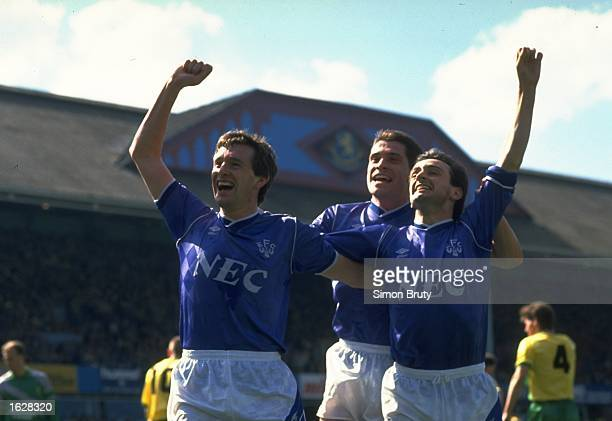 Kevin Sheedy Tony Cottee and Pat Nevin all of Everton celebrate a goal during the FA Cup SemiFinal against Norwich City at Villa Park in Birmingham...