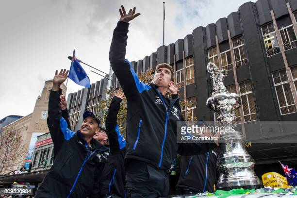 Kevin Shoebridge helmsman Peter Burling and CEO Grant Dalton wave as Emirates Team New Zealand parades the America's Cup through the streets of...