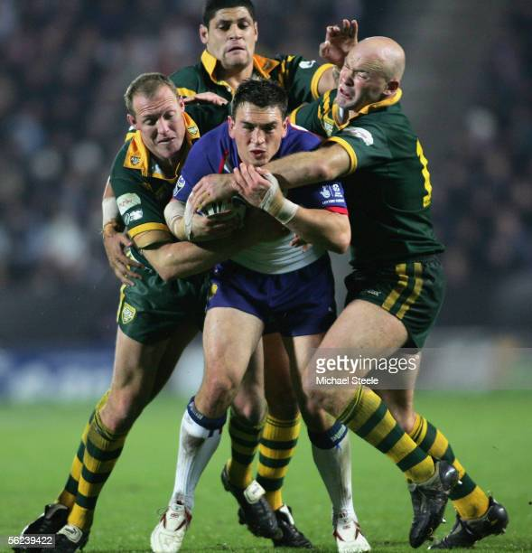 Kevin Sinfield of Great Britain is sandwiched by Craig Fitzgibbon Willie Mason and Ben Kennedy during the Gillette TriNations match between Great...