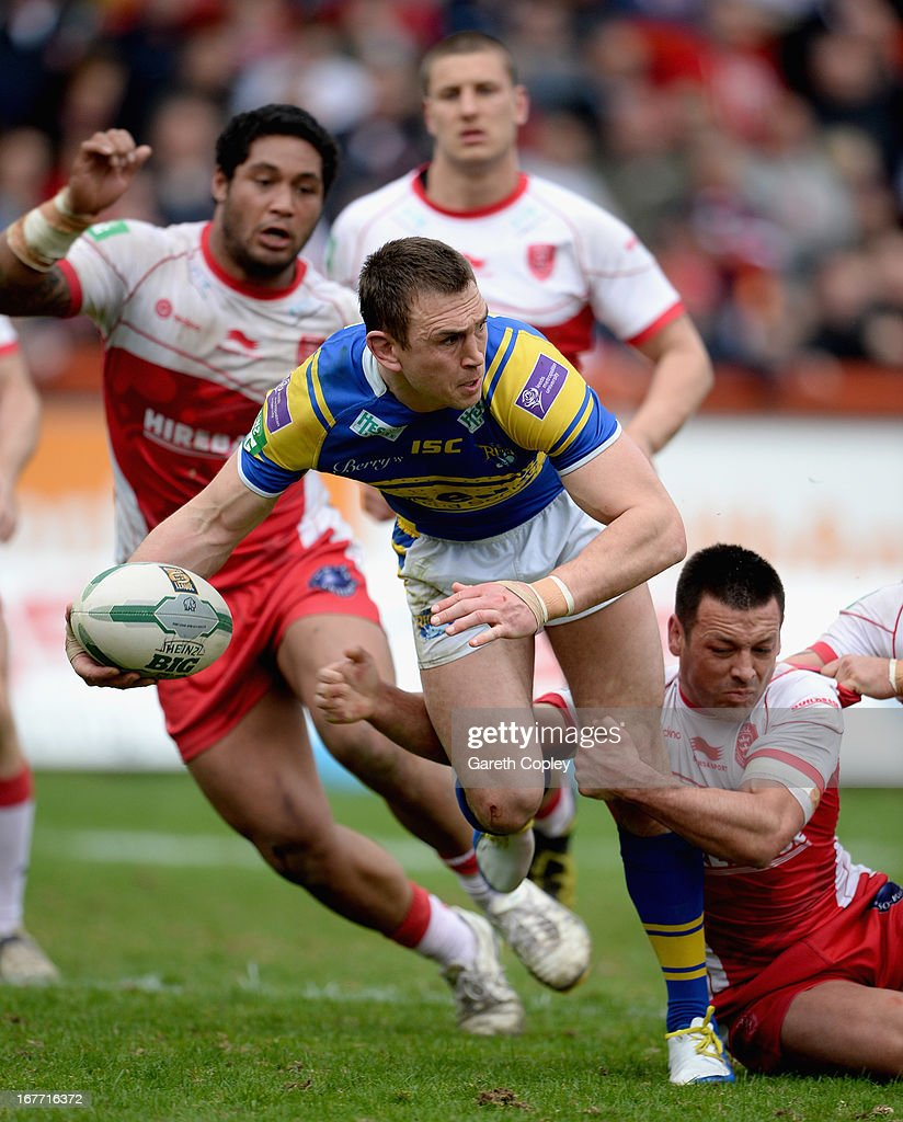 Kevin Sinfield of Leeds is tackled by Travis Burns of Hull KR during the Super League match between Hull Kingston Rovers and Leeds Rhinos at Craven Park Stadium on April 28, 2013 in Hull, England.
