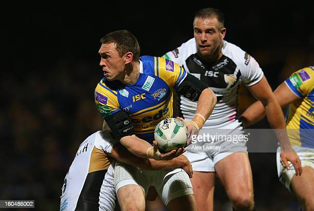 Kevin Sinfield of Leeds Rhinos is tackled by Daniel Holdsworth of Hull FC during the Stobart Super League match between Leeds Rhinos and Hull FC at...