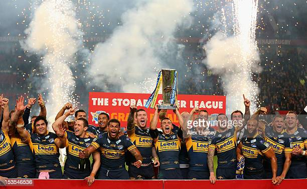 Kevin Sinfield of Leeds Rhinos lifts the trophy with his team mates following their victory at the end of the Stobart Super League Grand Final...