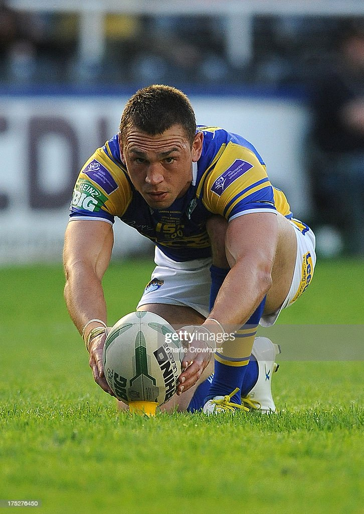 <a gi-track='captionPersonalityLinkClicked' href=/galleries/search?phrase=Kevin+Sinfield&family=editorial&specificpeople=240224 ng-click='$event.stopPropagation()'>Kevin Sinfield</a> of Leeds Rhinos lines up a kick during the Super League match between London Broncos and Leeds Rhinos at Twickenham Stoop on August 01, 2013 in London, England.