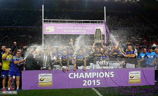 Kevin Sinfield of the Leeds Rhinos is sprayed with champagne as he celebrates with the trophy and his team mates after the First Utility Super League...