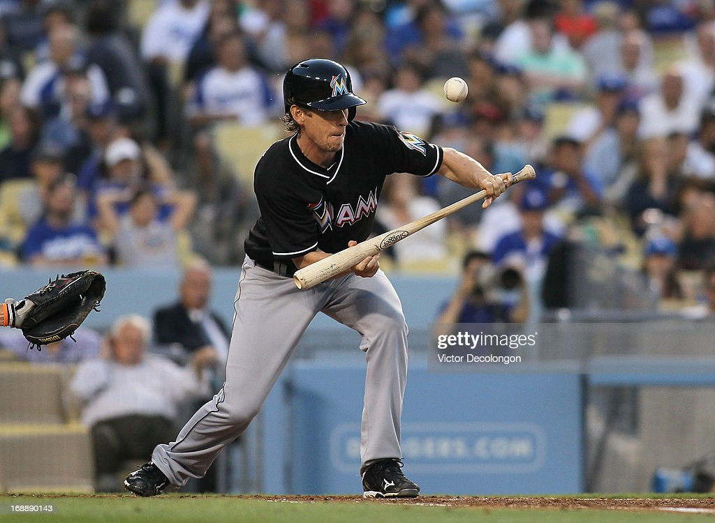 Kevin Slowey #45 of the Miami Marlins bunts during the MLB game against the Los Angeles Dodgers at Dodger Stadium on May 11, 2013 in Los Angeles, California. The Dodgers defeated the Marlins 7-1.