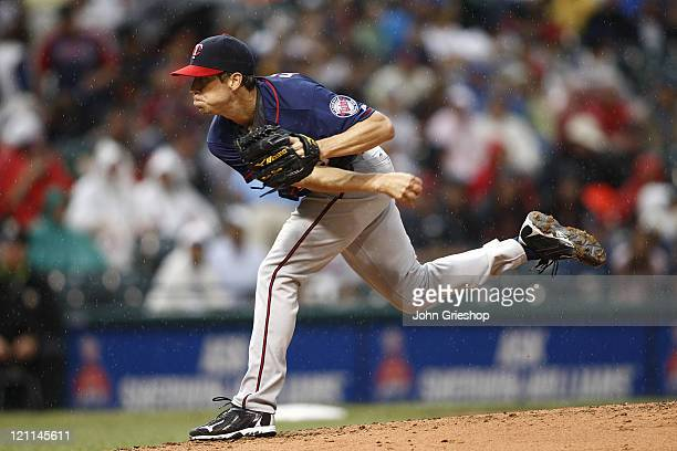 Kevin Slowey of the Minnesota Twins delivers a pitch during the game against the Cleveland Indians on August 14 2011 at Progressive Field in...