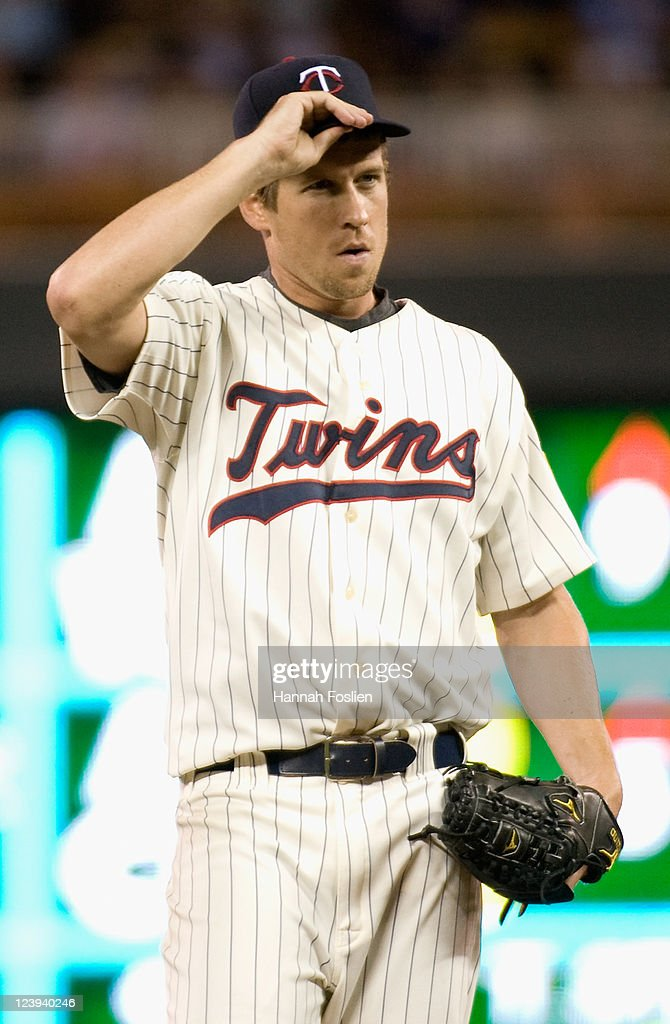 <a gi-track='captionPersonalityLinkClicked' href=/galleries/search?phrase=Kevin+Slowey&family=editorial&specificpeople=4175279 ng-click='$event.stopPropagation()'>Kevin Slowey</a> #59 of the Minnesota Twins reacts during the game against the Baltimore Orioles on August 24, 2011 at Target Field in Minneapolis, Minnesota.