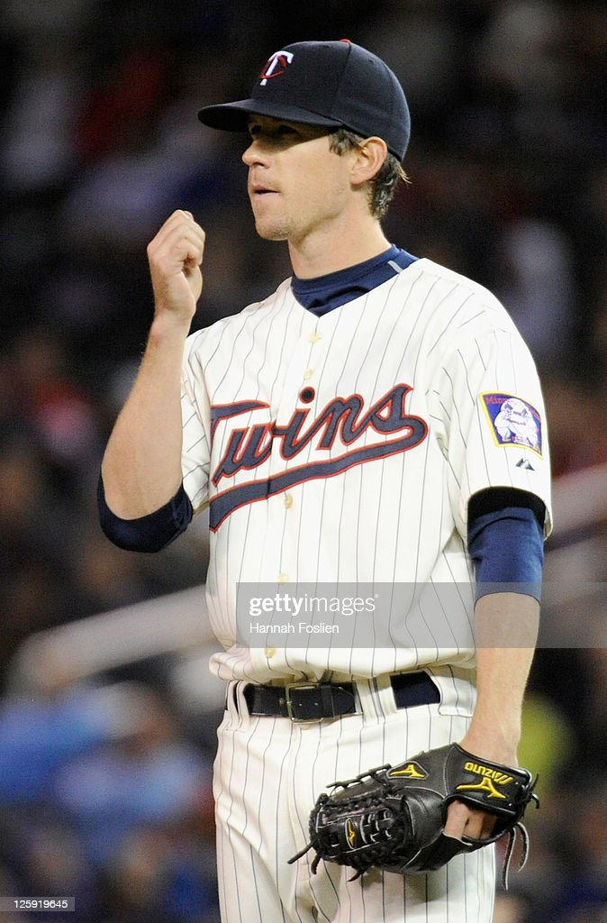 <a gi-track='captionPersonalityLinkClicked' href=/galleries/search?phrase=Kevin+Slowey&family=editorial&specificpeople=4175279 ng-click='$event.stopPropagation()'>Kevin Slowey</a> #59 of the Minnesota Twins reacts during the sixth inning against the Seattle Mariners on September 21, 2011 at Target Field in Minneapolis, Minnesota.