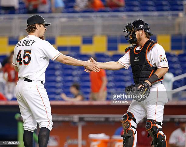 Kevin Slowey shakes hands with Jarrod Saltalamacchia of the Miami Marlins after the game against the Philadelphia Phillies at Marlins Park on May 21...
