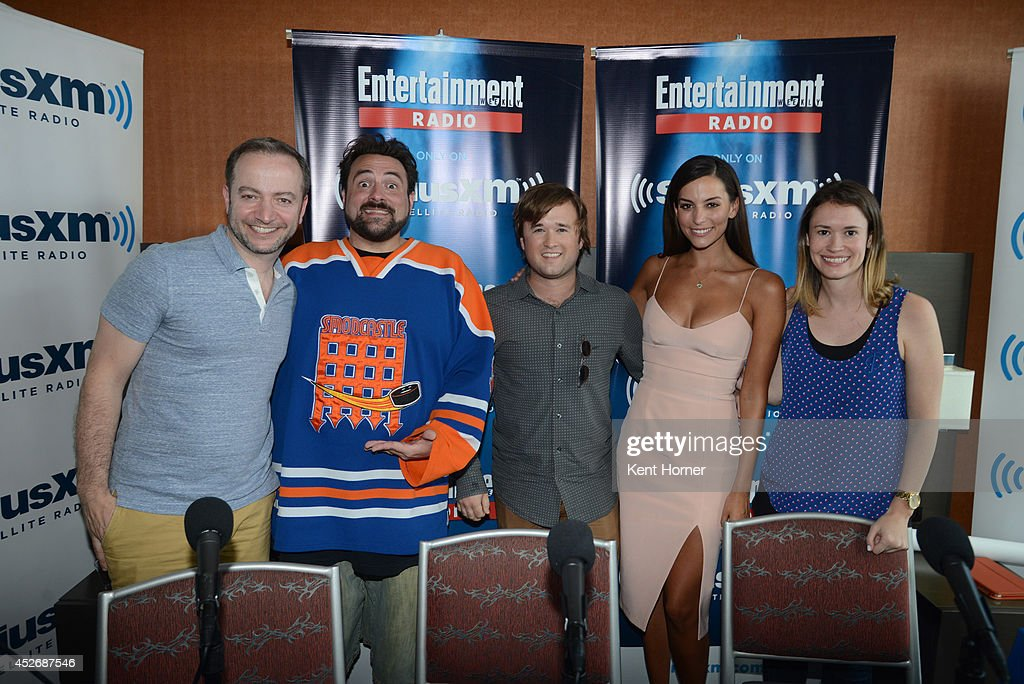 Kevin Smith , Haley Joel Osment and Genesis Rodriquez poses with radio hosts Mario Correa and Julia Cunningham pose after being interviewed on SiriusXM's Entertainment Weekly Radio channel from Comic-Con 2014 at The Hard Rock Hotel on July 25, 2014 in San Diego, California.