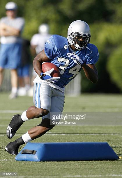 Kevin Smith of the Detroit Lions runs a drill during training camp at the Detroit Lions Headquarters and Training Facility on July 24 2008 in Allen...