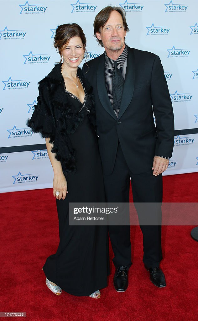 Kevin Sorbo and wife Sam Sorbo walk the red carpet before the 2013 Starkey Hearing Foundation's 'So the World May Hear' Awards Gala on July 28, 2013 in St. Paul, Minnesota.