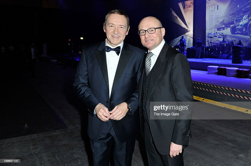 <a gi-track='captionPersonalityLinkClicked' href=/galleries/search?phrase=Kevin+Spacey&family=editorial&specificpeople=202091 ng-click='$event.stopPropagation()'>Kevin Spacey</a> and <a gi-track='captionPersonalityLinkClicked' href=/galleries/search?phrase=Georges+Kern&family=editorial&specificpeople=623163 ng-click='$event.stopPropagation()'>Georges Kern</a> attend the IWC Schaffhausen Race Night event during the Salon International de la Haute Horlogerie (SIHH) 2013 at Palexpo on January 22, 2013 in Geneva, Switzerland.