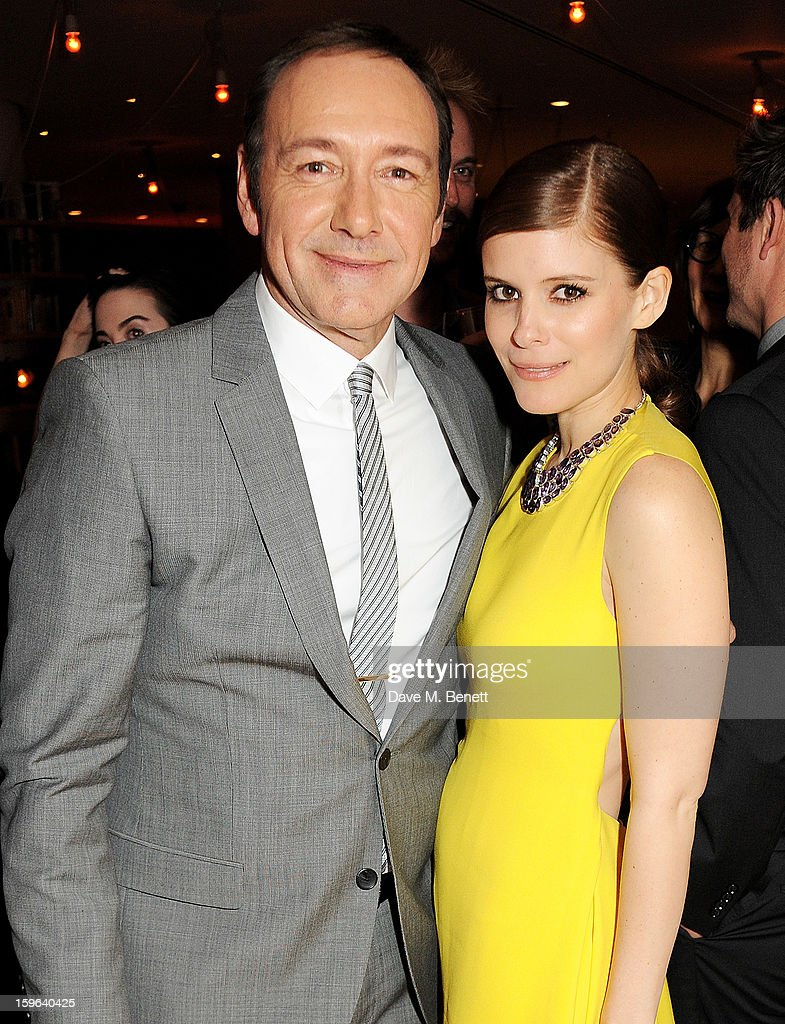 Kevin Spacey (L) and Kate Mara attend an after party celebrating the Red Carpet Premiere of the Netflix original series 'House of Cards' at Asia de Cuba, St Martins Lane Hotel, on January 17, 2013 in London, England.