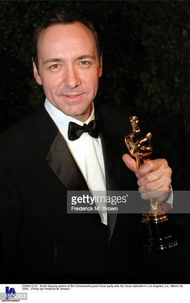 Kevin Spacey arrives at the Dreamworks postOscar party with his Oscar statuette in Los Angeles Ca March 26 2000
