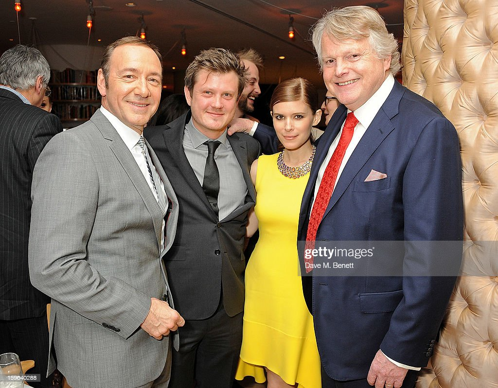 (L to R) Kevin Spacey, Beau Willimon, Kate Mara and Lord Michael Dobbs attend an after party celebrating the Red Carpet Premiere of the Netflix original series 'House of Cards' at Asia de Cuba, St Martins Lane Hotel, on January 17, 2013 in London, England.