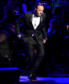 Kevin Spacey performs onstage during The 2014 Revlon Concert For The Rainforest Fund at Carnegie Hall on April 17 2014 in New York City