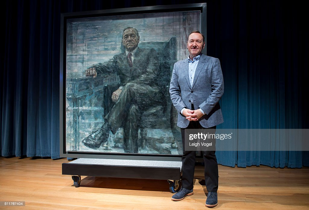 Kevin Spacey poses for a photo with a portrait of President Frank Underwood at a press conference hosted by The Smithsonian and Netflix at the...