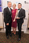 Kevin Spacey Robin Wright and Dana Brunetti pose with an award at the 17th Annual Webby Awards at Cipriani Wall Street on May 21 2013 in New York City